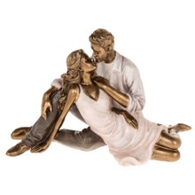 Couple Kissing Figurine